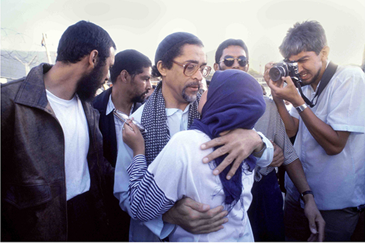 Ahmed Cassiem greets his daughter after he is released from Robben Island in 1990.