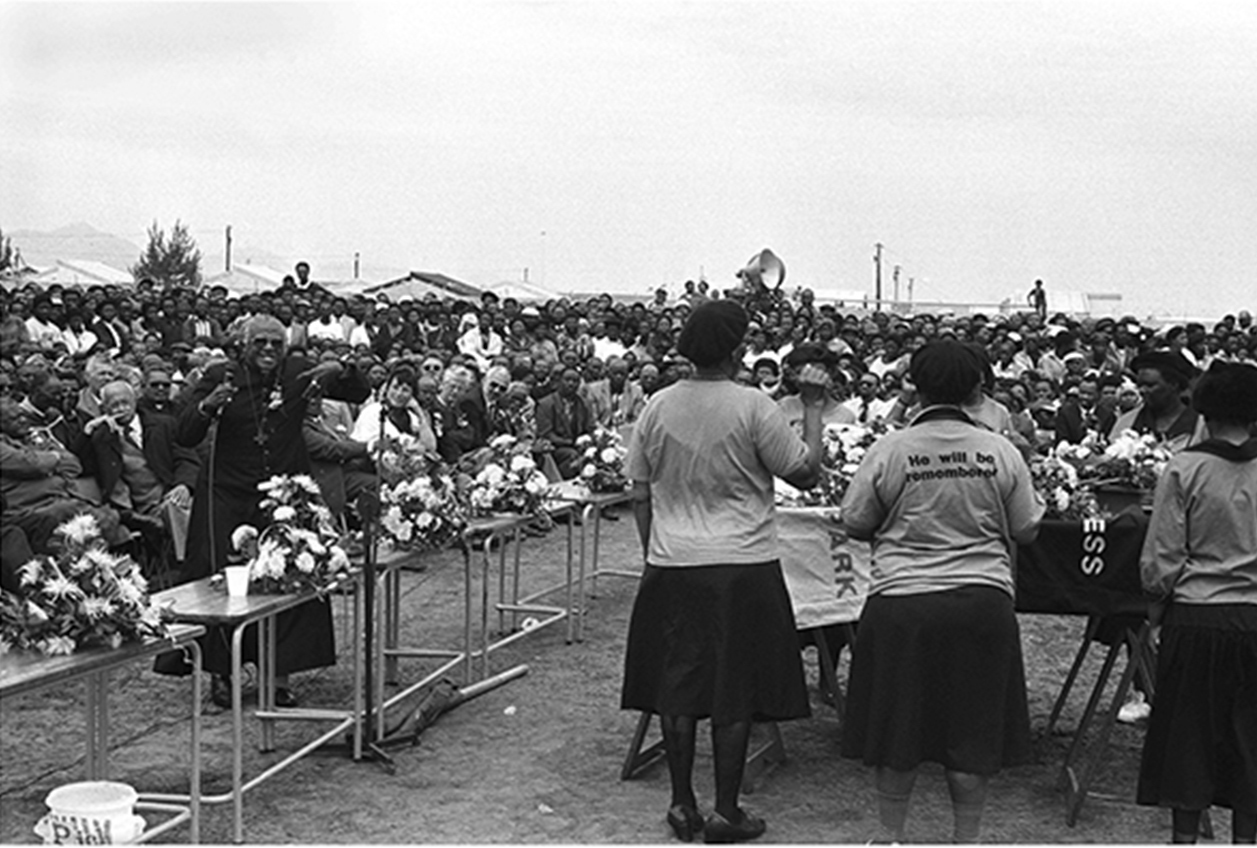Archbishop Tutu speaking in Khayelitsha where the ANC Women's League pays tribute at a funeral of murdered civic leader, Michael Mapongwana in 1991.