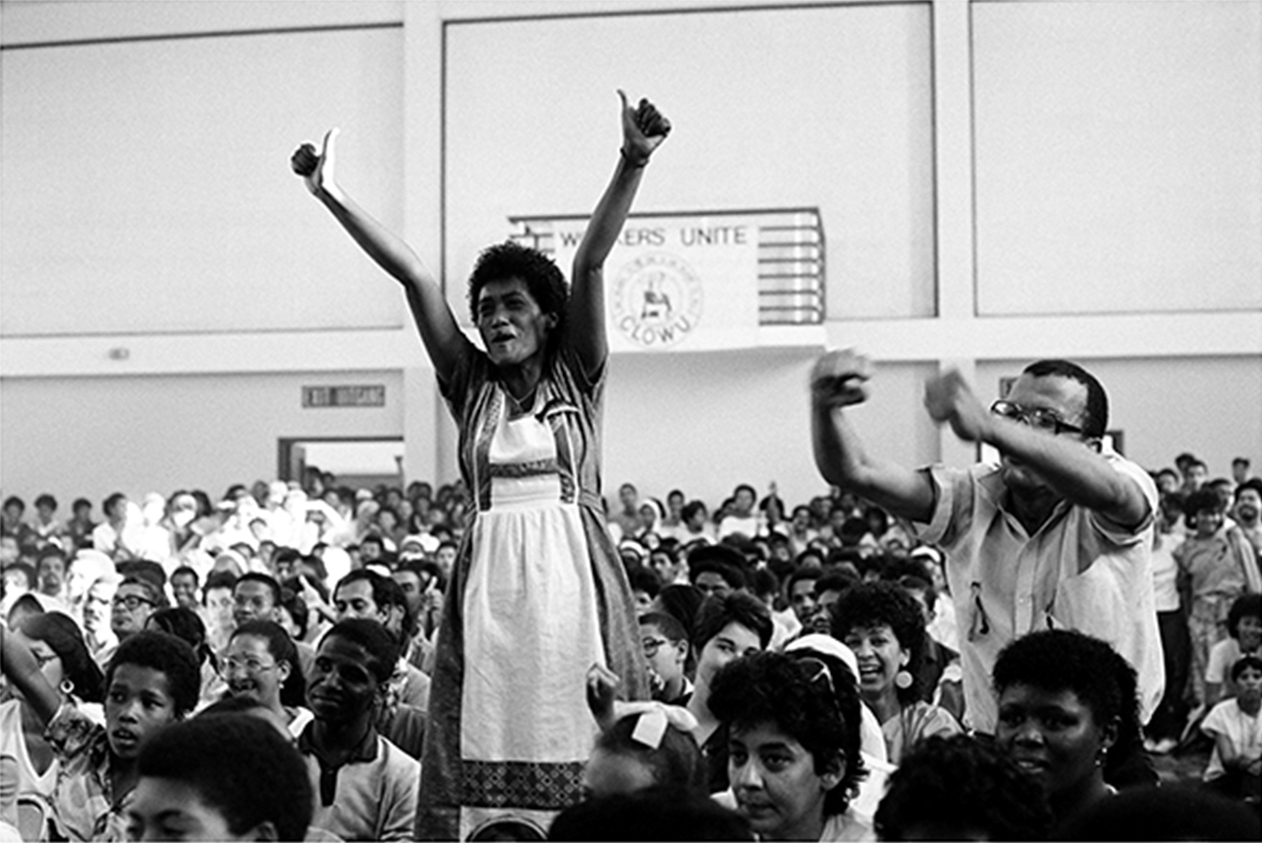 Activist June Esau in a celebrative mood at a mass meeting in Bonteheuwel Civic Centre in Cape Town