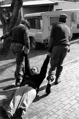 Rev. Michael Weeder being dragged after a teargas attack, June 1990