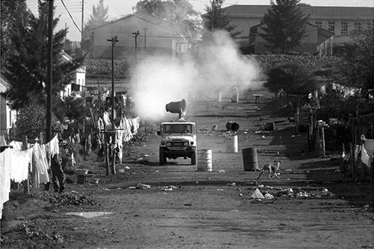 Police use the sneeze machine in Ashton during the 1990 Defiance Campaign
