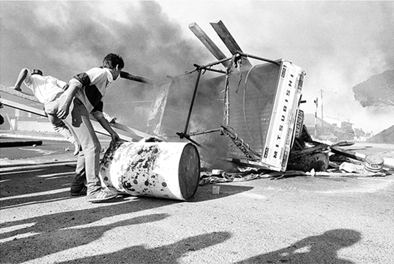 Youth protest, and barricades erected as a defence against police brutality, Belgravia Road, Athlone, Cape Town, 1985.