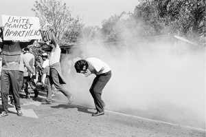 Student protesters overwhelmed by teargas on the University of the Western Cape campus, Bellville, Cape Town