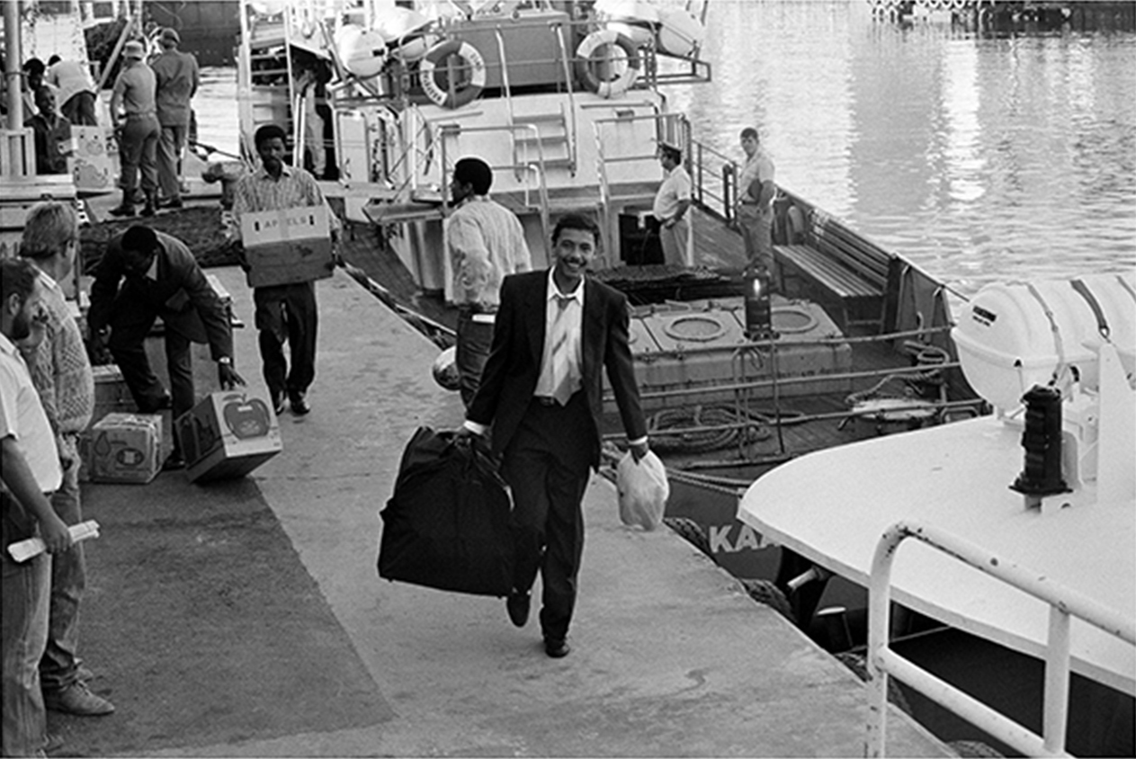 Ashley Forbes amongst freed political prisoners disembarking at Cape Town harbour on their release from Robben Island prison. 1991.