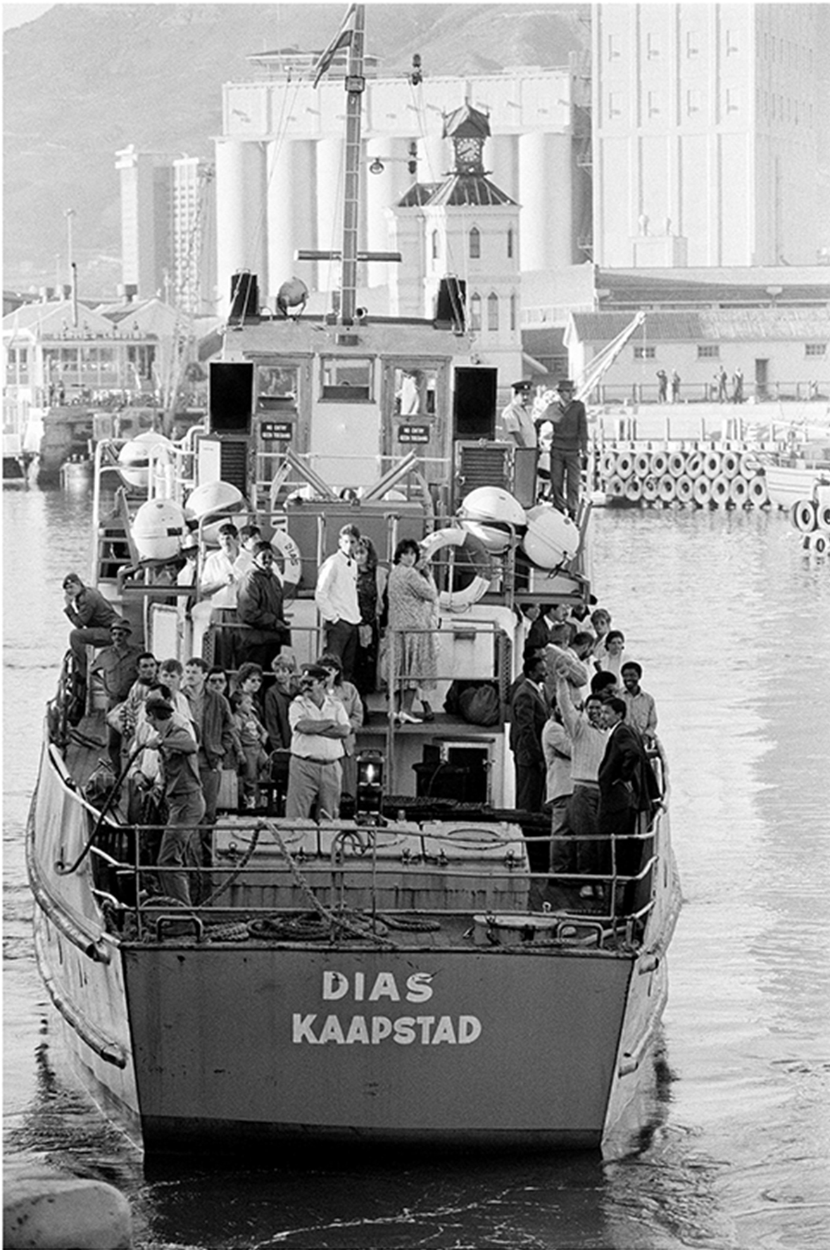 Accompanied by prison personnel, political prisoners on their release from Robben Island prison, in Cape Town Harbour