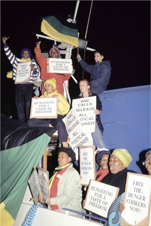 Relatives and supporters of the remaining Robben Island prisoners stage a demonstration on board a ferry to highlight the plight of hunger strikers on the island