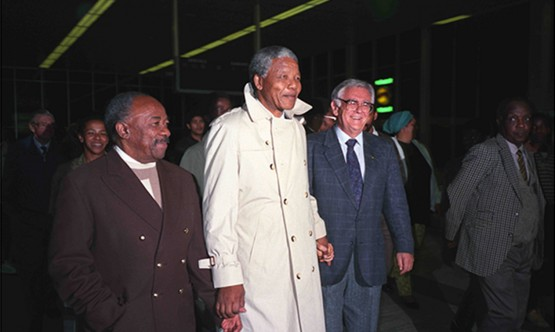 Nelson Mandela is flanked by Alfred Nzo and Joe Slovo at DF Malan Airport to welcome newly returned ANC and SACP exiles