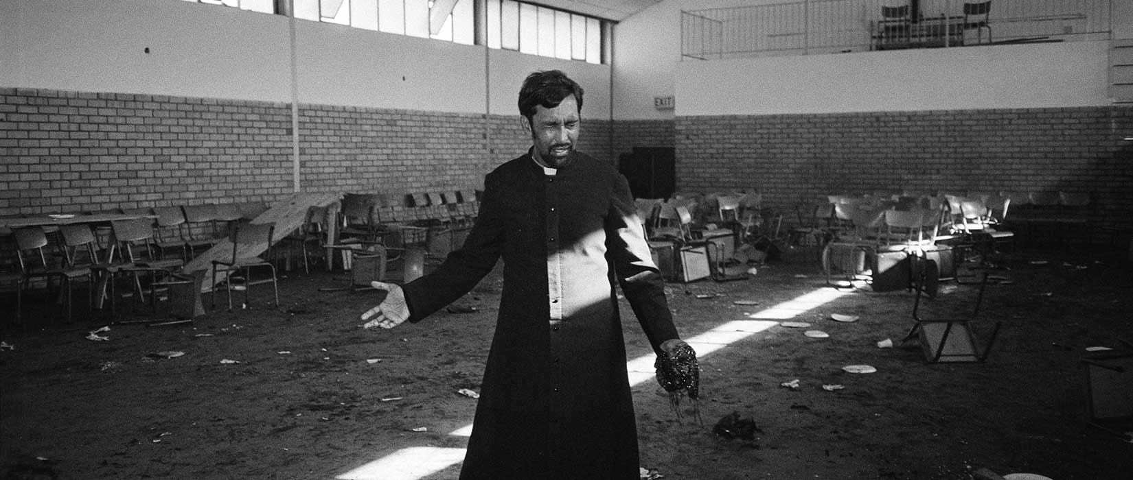 Father PJ Pearson in the church hall where the congregation were tear-gassed and attacked by police after the funerals of ANC members Robbie Waterwitch and Coline Williams